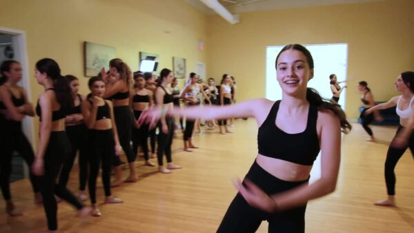 competitive dancer mid twirl inside dance studio near vaughan