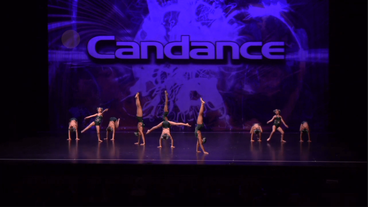Competitive acro dance team on stage at dance competition in richmond hill