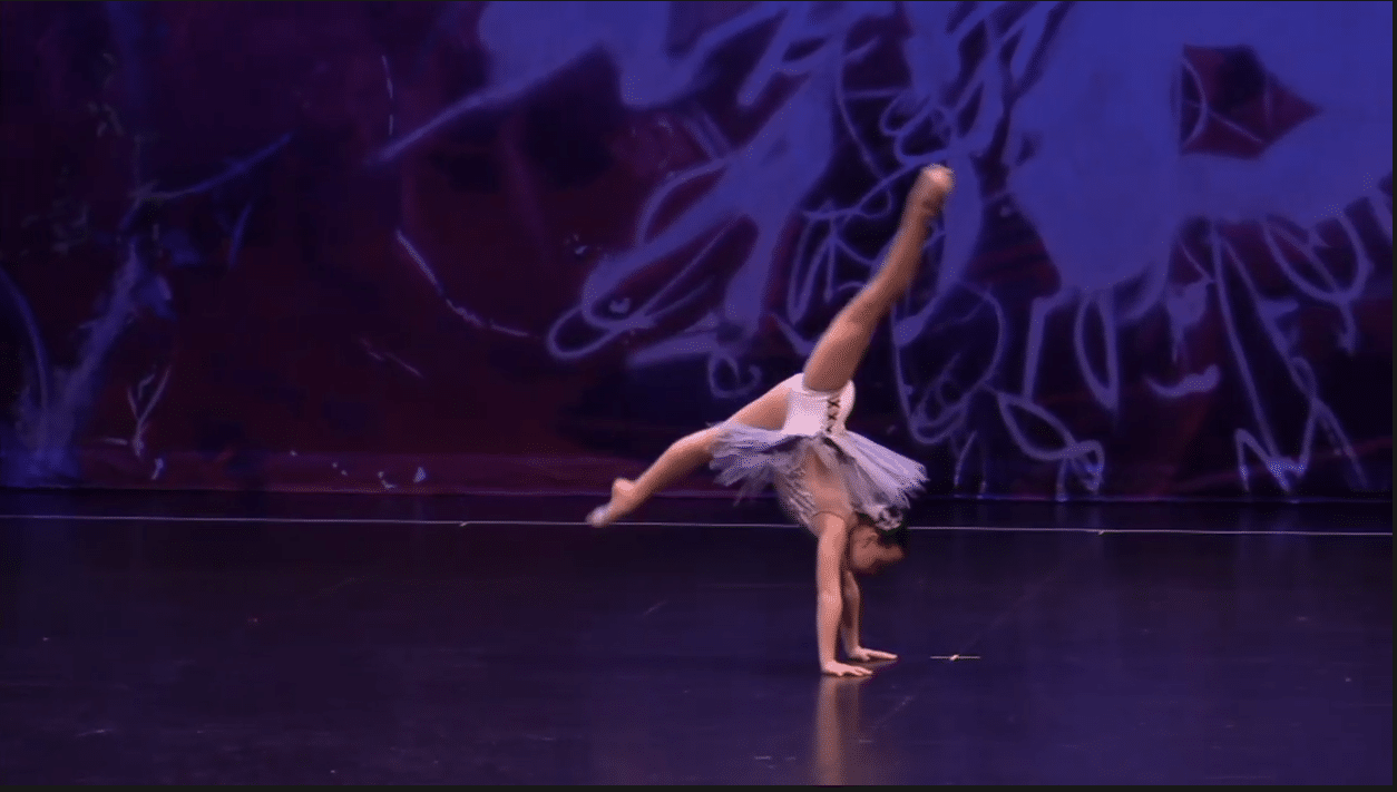Competitive contemporary solo dancer on stage at dance competition in richmond hill
