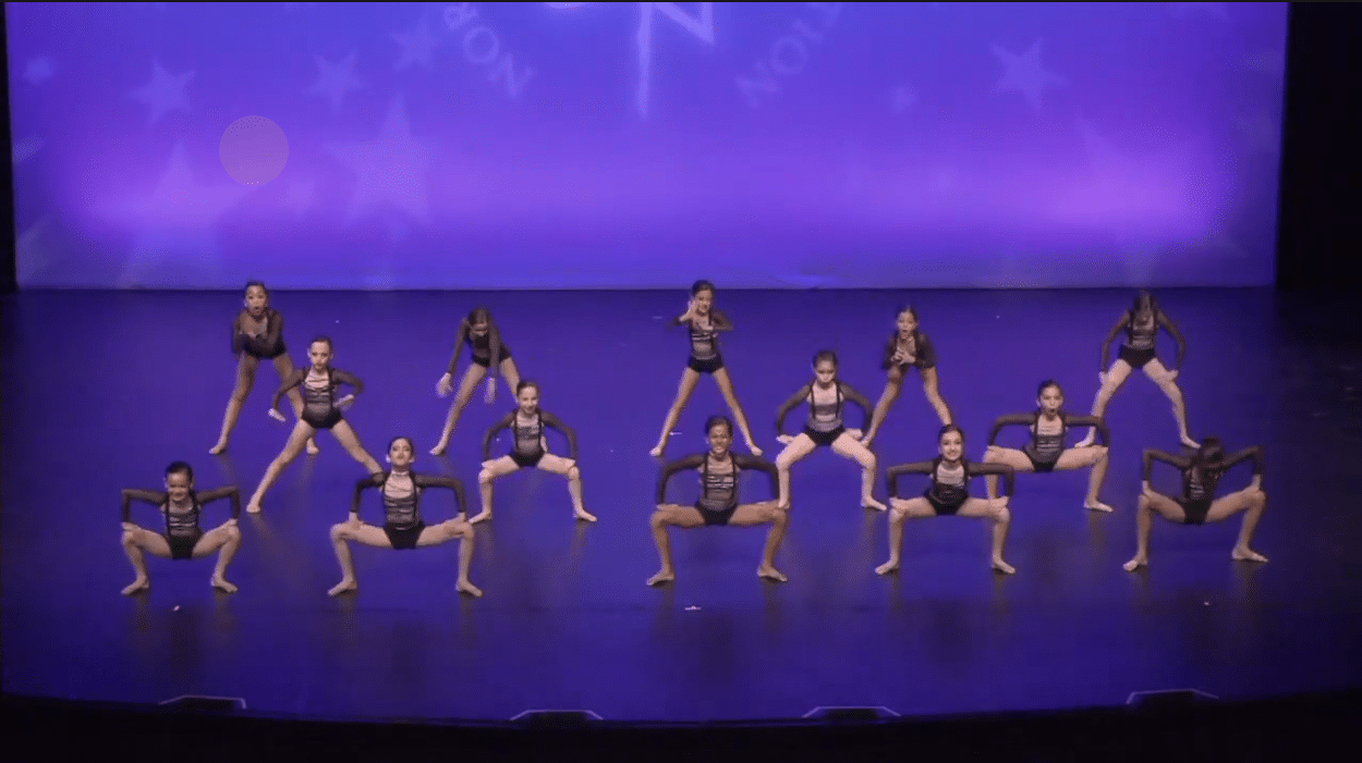 Competitive junior jazz dance group on stage at dance competition in richmond hill