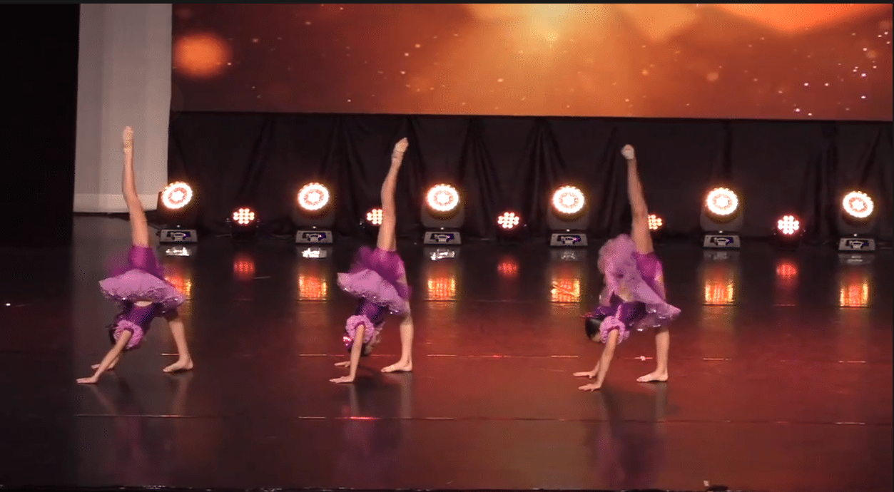 Competitive junior jazz trio dance group on stage at dance competition in richmond hill