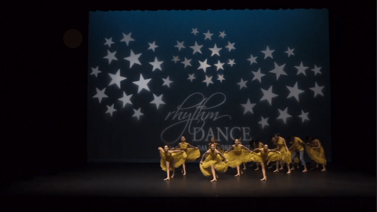 Competitive lyrical team on stage at dance competition in richmond hill