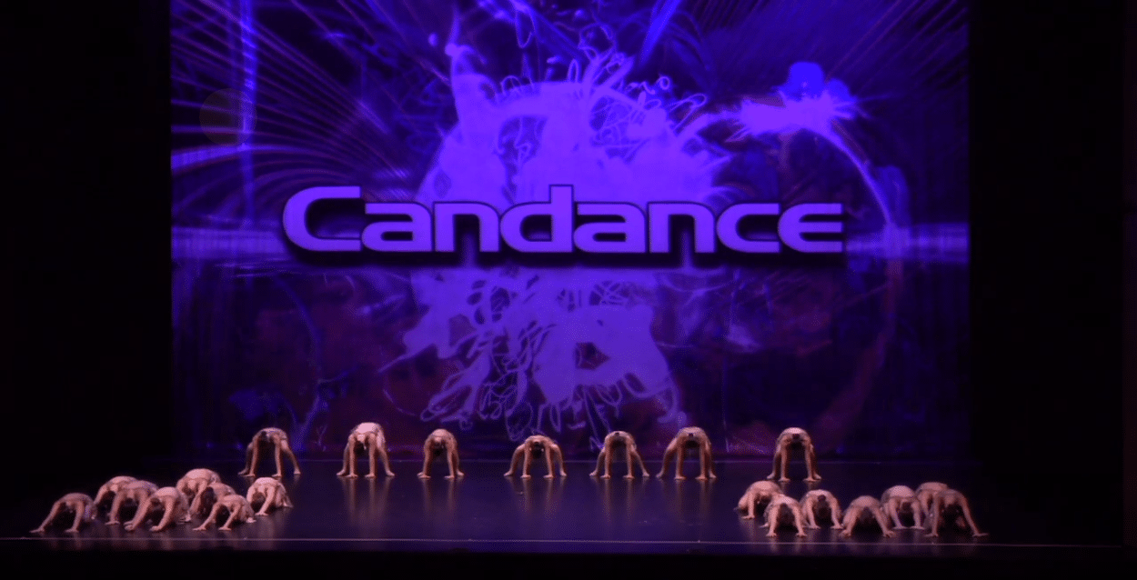 Competitive lyrical dance team on stage at dance competition in thornhill