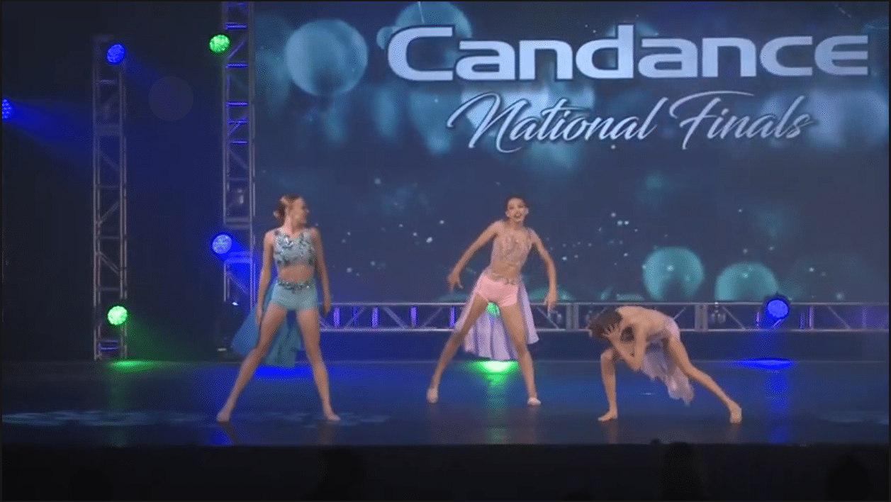 Competitive lyrical dancers on stage at dance competition in richmond hill