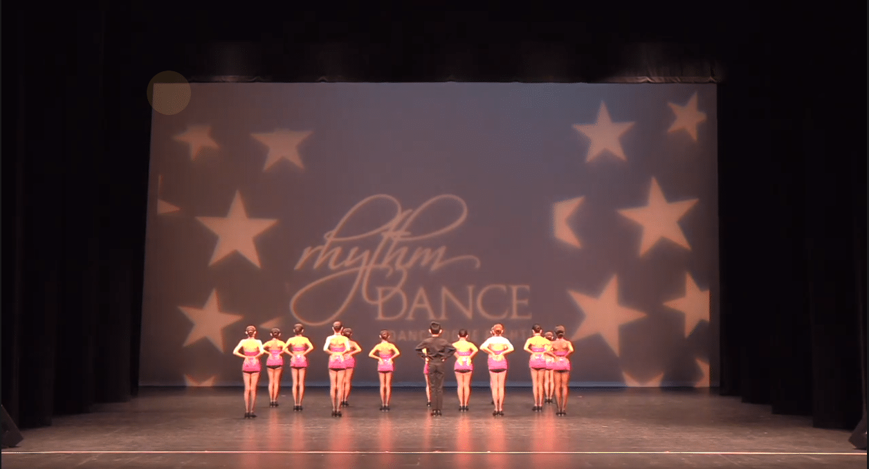 Competitive tap dance group on stage at dance competition in richmond hill