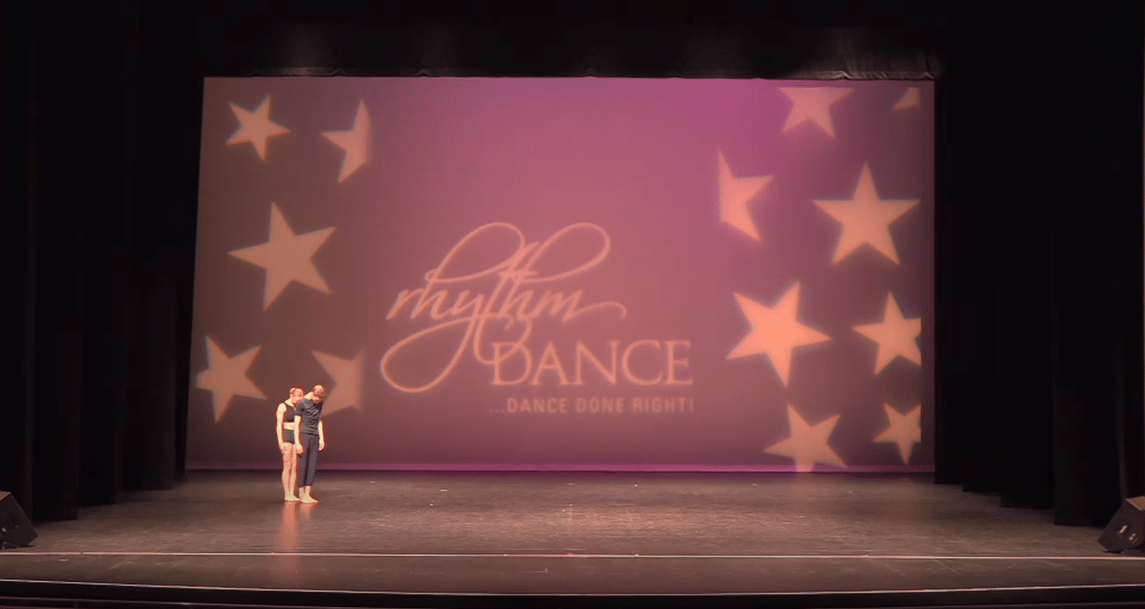 Competitive acro dancers on stage at dance competition in richmond hill