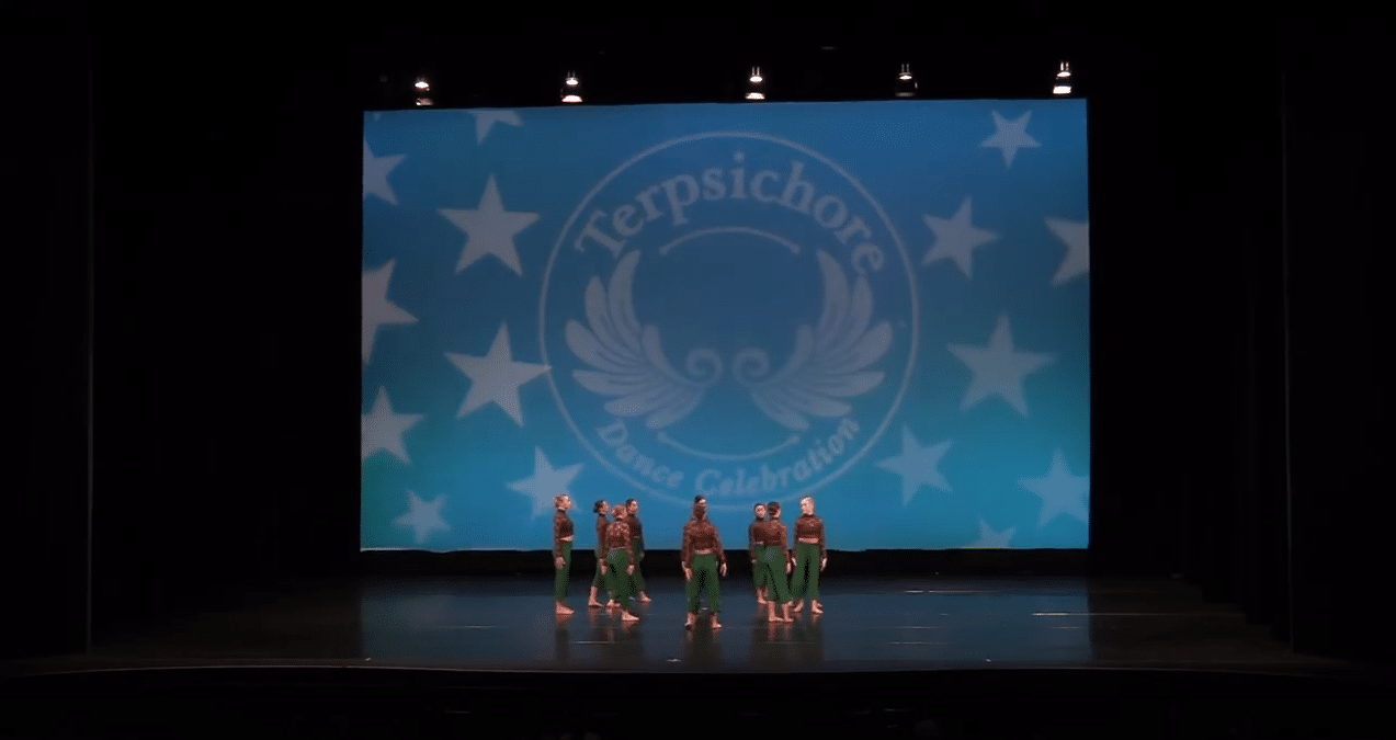 Competitive acro dancer on stage at dance competition in richmond hill