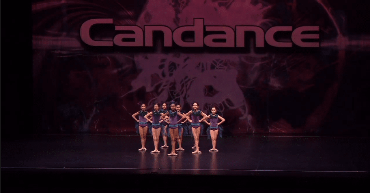 Competitive ballet dance team on stage at dance competition in king city