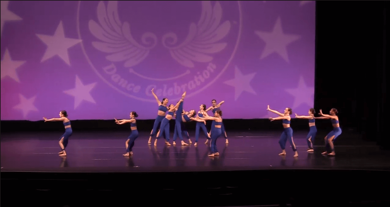 Competitive contemporary dancers on stage at dance competition in thornhill