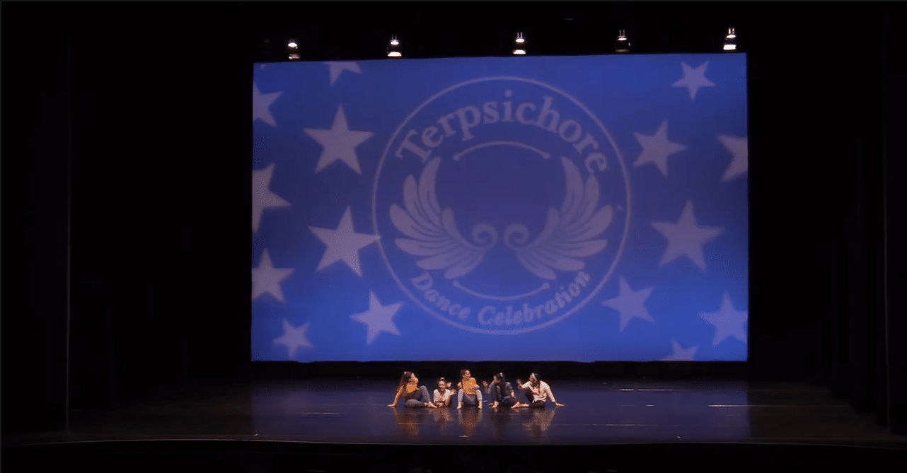 Competitive contemporary dances on stage at dance competition in richmond hill