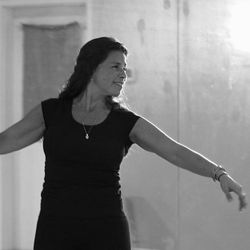 ballet teacher at jcb danceworks near maple ontario doing a ballet dance move in the dance studio