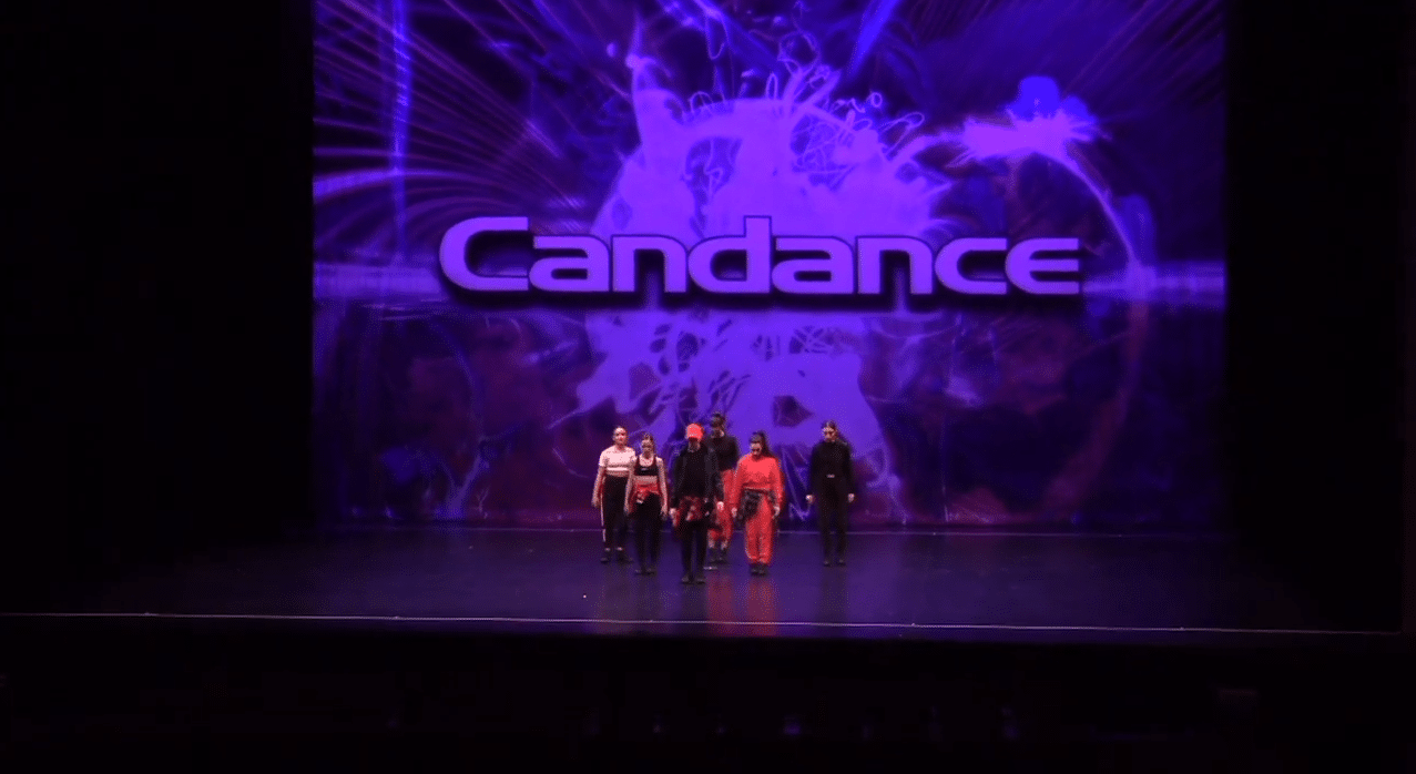 Competitive hip hop dancers on stage at dance competition in vaughan