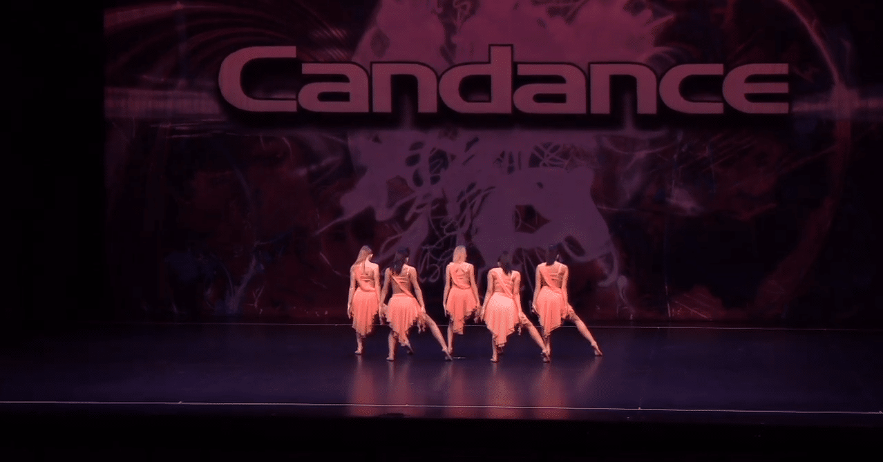 Competitive jazz dancers on stage at dance competition in richmond hill