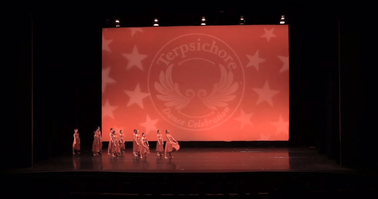 Competitive lyrical dance team on stage at dance competition in richmond hill