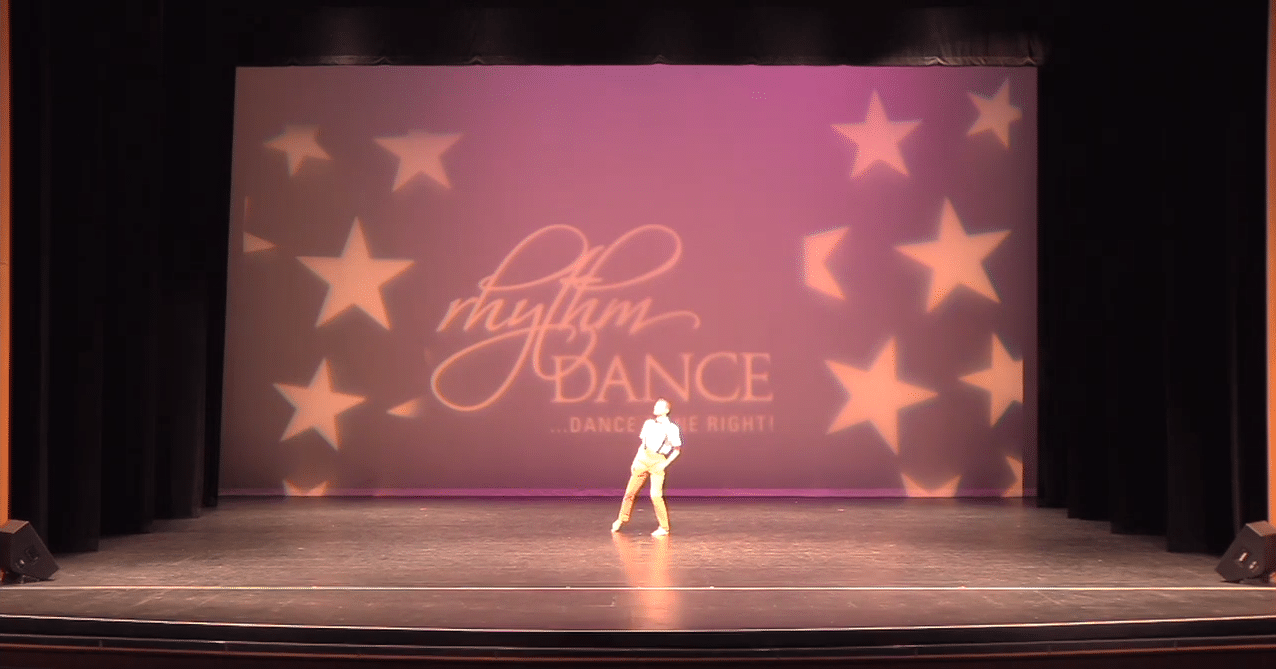 Competitive lyrical dancer on stage at dance competition in york region
