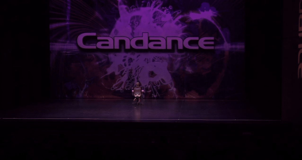 Competitive dancer on stage at dance competition in richmond hill