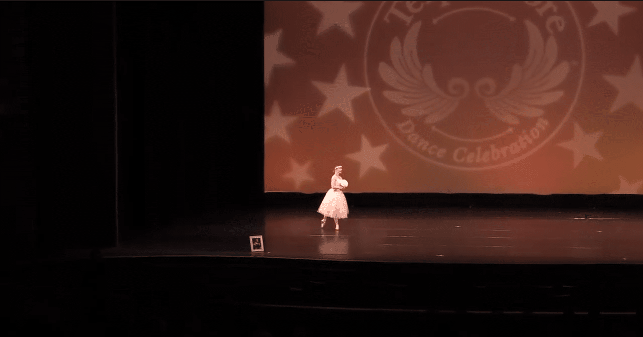 Competitive pointe solo dancer on stage at dance competition in york region