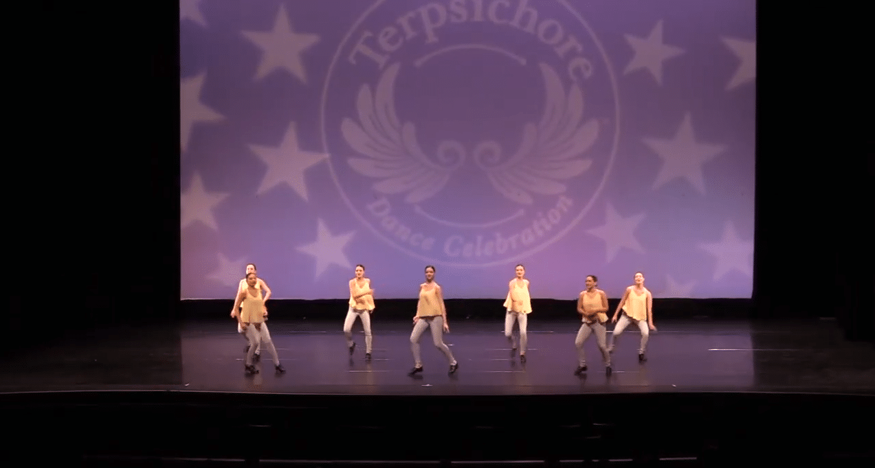 Competitive tap dance team on stage at dance competition in richmond hill