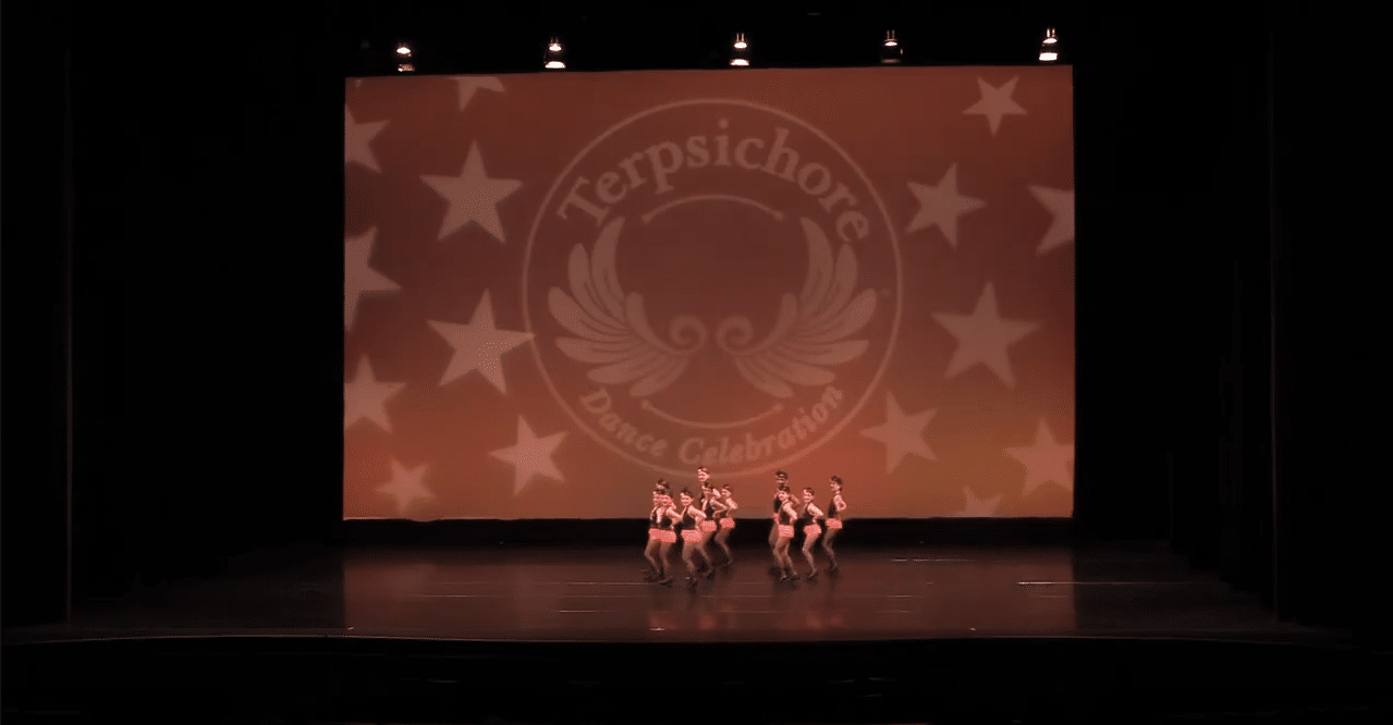 Competitive tap dancers on stage at dance competition in vaughan